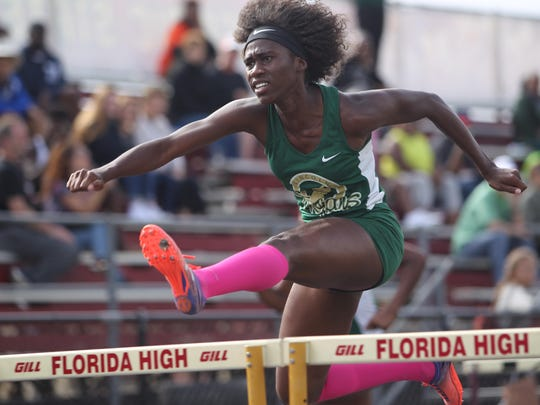 Lincoln's TeJyrica Robinson clears a hurdle on the way to a win in the 100 hurdles during Saturday's District 3-3A meet at Florida High. Robinson also is a key member of the 4x400 relay.