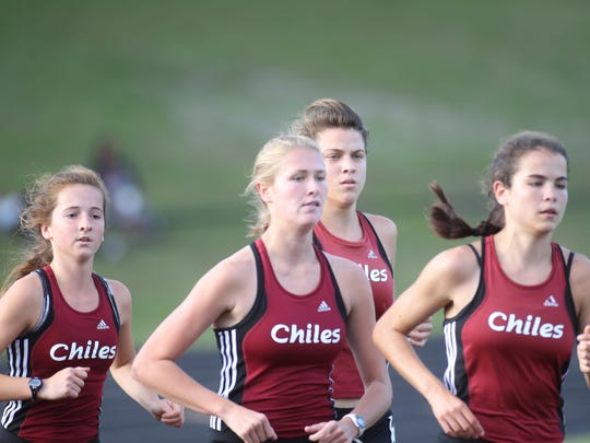Chiles finished 1-2-3-4 in the 3200, led by sophomore Ana Wallace, far right, who won a second district title following an earlier win in the 1600.