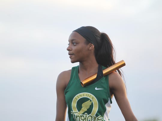 Lincoln's Tamera Mason eyes her starting path in the 4x400 relay.