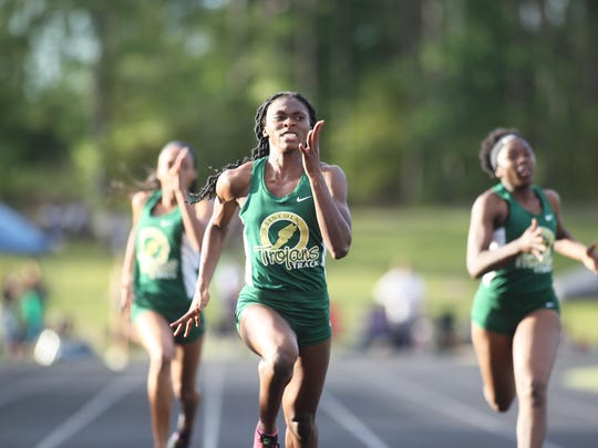Lincoln's Tamani Wilson sprints home to victory in the 400 on Saturday, claiming the second of two district titles.