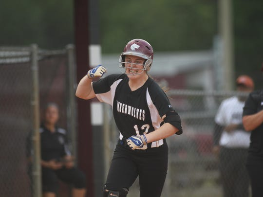 Chiles third baseman Karli Woolington celebrates after hitting a three-run home run, her 12th of the year, in the first inning of a 7-5 loss to Atlantic Coast on Wednesday in a Region 1-8A quarterfinal.