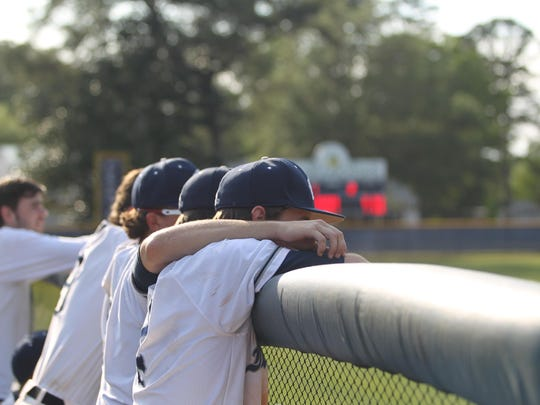 Maclay players watch as their team tries to rally for a win during NFC's 2-1 win Thursday in the district championship game.