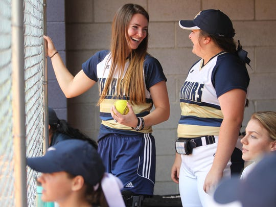 Aucilla Christian pitcher Elizabeth Hightower, who missed her sophomore season with a major knee injury, laughs with teammates in the dugout during the Warriors' 10-0 win that landed them back in the state tournament.