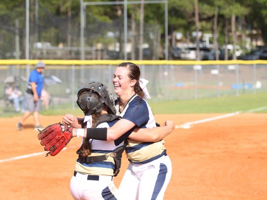 Aucilla pitcher Abigail Morgan hugs catcher Kelly Horne after a strikeout ended the Warriors' 10-0 win over Countryside Christian on Tuesday to send the Warriors back to the state tournament.