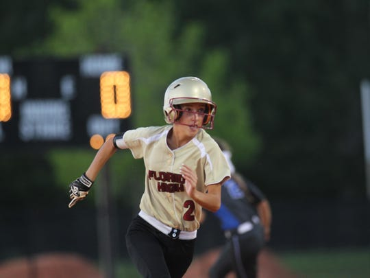 Florida High's Faith McDaniel races into third base after tripling late in the Seminoles' 4-2 loss to Trinity Christian on Tuesday in a 4A regional final.