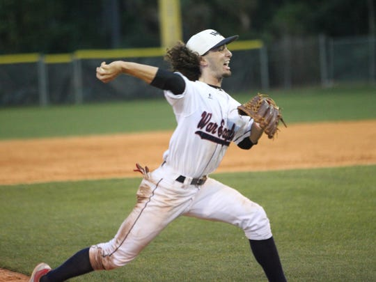 Wakulla third baseman Jared Weber throws home to catch a West Florida runner that tried to score from second on a hit.