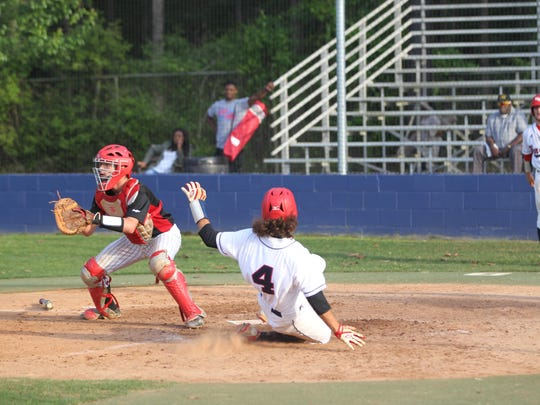Wakulla's John Weber slides in safely to home during an early four-run surge by the War Eagles in a 6-5 loss to West Florida on Wednesday in a Region 1-6A quarterfinal.