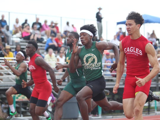 Lincoln's Marquel Pittman speeds past competitors in the 100-meter dash during Thursday's Region 3-3A meet. Pittman finished second.