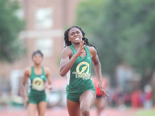 Lincoln's Tamani Wilson races to victory in the 400-meter dash on Thursday in the Region 3-3A meet. Wilson also won the 200 and was on the victorious 4x400 relay.