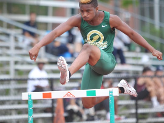 Lincoln's Kai Davis Jr. clears a hurdle during his 300-meter hurdle race on Thursday in the Region 3-3A meet. Davis Jr. finished with a PR and took second, securing his trip to the state meet.
