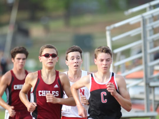 Chiles sophomore Matthew Newland, followed by teammate Michael Phillips and Leon's Matthew Cashin try to keep pace with Creekside's Matthew Clark during the 3200-meter run in Thursday's Region 3-3A meet. Newland won, his first victory ever.