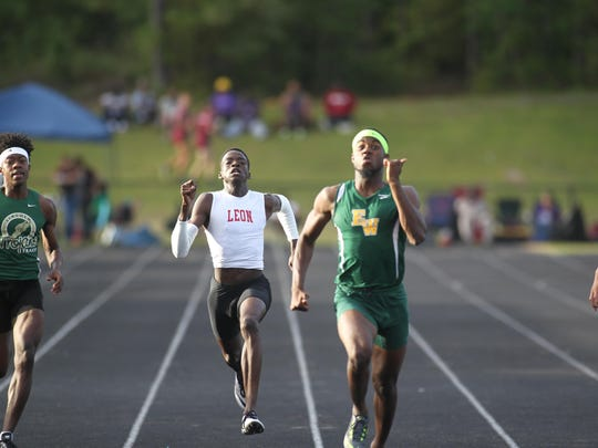 Leon's Leander Forbes tries to catch an Ed White sprinter during the 200-meter final in the District 3-3A meet.