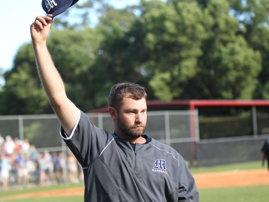 Maclay coach Drew Sherrod tips his cap to the Marauders' fans after his baseball team secured the program's first trip to the state tournament since 1993 with a 1-0 win over NFC in extra innings.