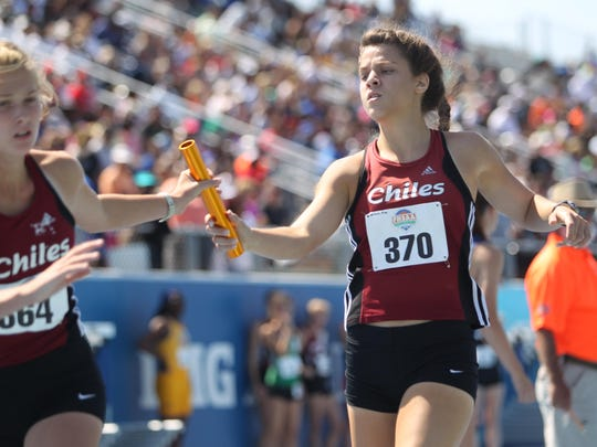 Chiles senior Alexandra Wallace hands the baton to freshman Lawton Campbell during the 4x800 relay at Saturday's state meet. The Timberwolves finished fourth in the race.