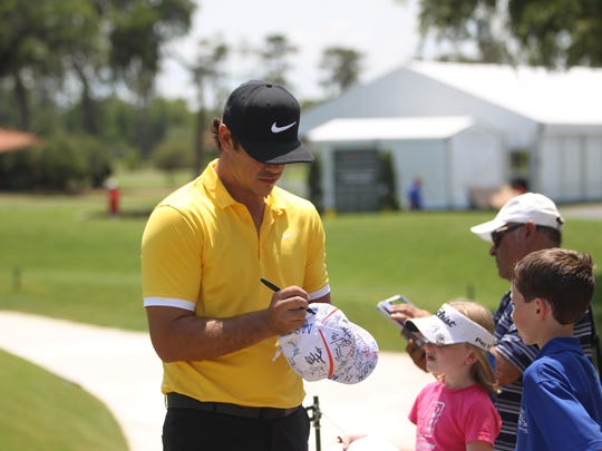 Former FSU golfer Brooks Koepka, 26, signs autographs for children following a Tuesday practice round at TPC Sawgrass in advance of THE PLAYERS Championship.