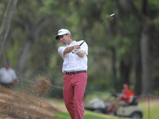 Former FSU golfer George McNeill hits a shot from the pine straw during a Wednesday practice round at TPC Sawgrass in preparation for THE PLAYERS Championship.