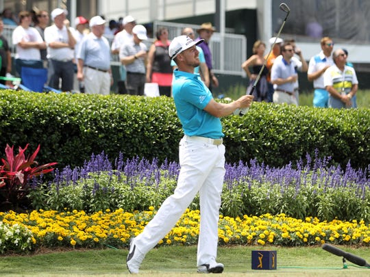 Former FSU golfer Jonas Blixt tees off on the famed par-3 17th hole at TPC Sawgrass during THE PLAYERS Championship.
