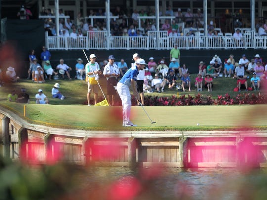 Former FSU golfer Jonas Blixt putts on the famed par-3 No. 17 island green at TPC Sawgrass during THE PLAYERS Championship.