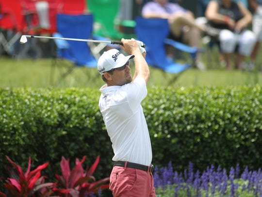 Former FSU golfer George McNeill watches his tee shot from the par-3 17th hole at TPC Sawgrass, known for its island green.