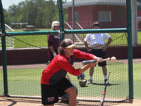 Leon's Nick Collins practices bunting before hitting BP during practice with summer league team Tallahassee Post 13.