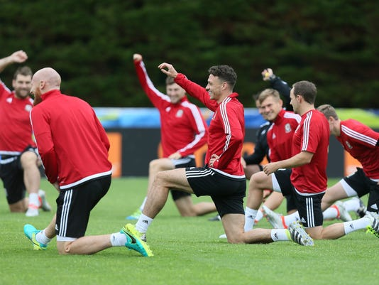 Wales' James Chester, center, stretches during a training session in Dinard, western France, Tuesday, July 5, 2016. Wales will face Portugal in a Euro 2016 semifinal match at the Grand Stade in Decines-Charpieu, near Lyon, France, Wednesday, July 6, 2016. (AP Photo/David Vincent)