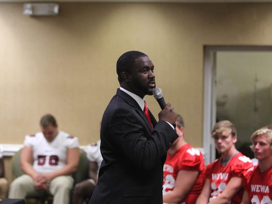 Former Lincoln football star Ryan Gilliam, 31, spoke to high school football players Tuesday during 4QuartersOnline Media Day. Gilliam was a highly touted recruit out of high school, but he spoke about the education he gained that turned into a successful business career.