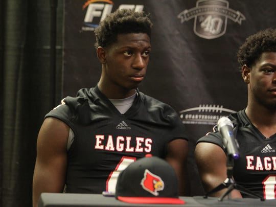 NFC senior safety Lyn Strange committed last week to the University of Louisville, and he brought a new hat to 4QuartersOnline Football Media Day to display his pride.