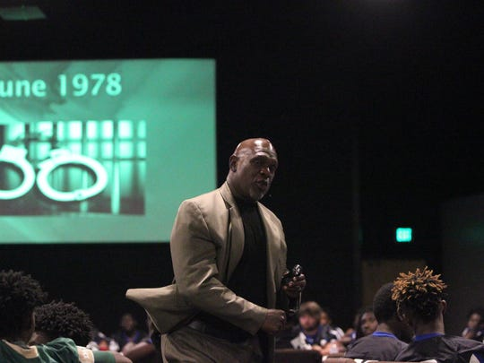 Former Miami Hurricanes linebacker Bernard Clark speaks to local high school football players on Friday evening at City Church's Team Tallahassee event.