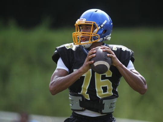 """Rickards quarterback D.J. Phillips is the Raiders' """"heart and soul"""" according to coach Quintin Lewis."""