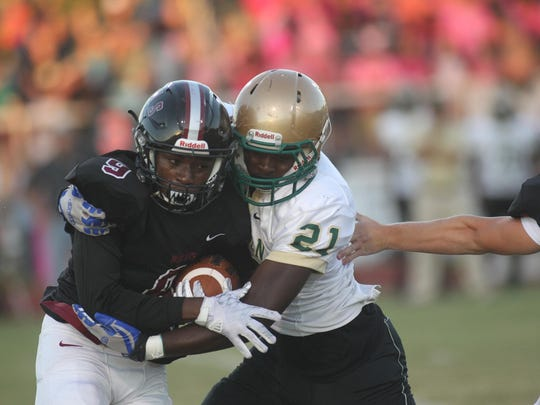 Chiles running back Shane Sanders is tackled by Lincoln's Shakel Brown during their game Friday night.