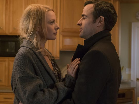 """Haley Bennett, left, and Justin Theroux appear in a scene from """"The Girl on the Train."""""""