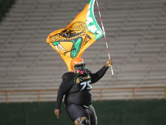 Rattlers lineman Keldrick Harley brings his team on the field. The FAMU DRS football team defeated Maclay 26-22 on Friday night at Bragg Memorial Stadium.