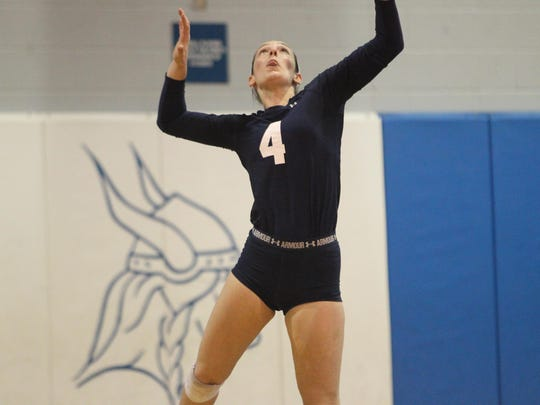 Maclay's Siena Kole serves against Lincoln.