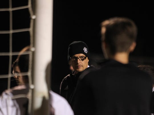 Chiles coach Bryan Wilkinson speaks to his team at halftime during a recent game.