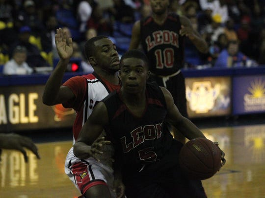 Leon senior Israel Chipman drives against an Osborne defender during Wednesday's game at TCC in the Capital City Holiday Classic.