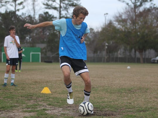Lincoln junior Cole Payne, who leads the Trojans with 16 goals, goes through a drill during Wednesday's practice.