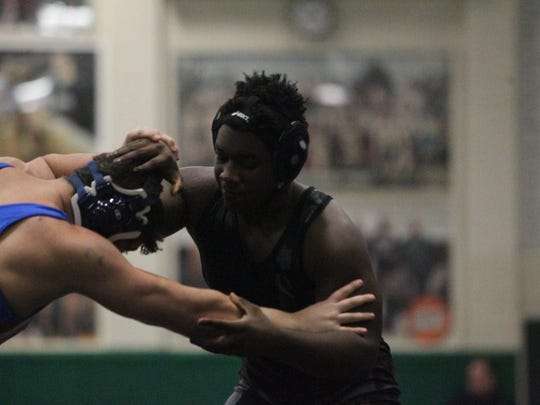 Chiles' Bobby Williams wrestles at 220 pounds during Saturday's Trojans Invitational at Lincoln.