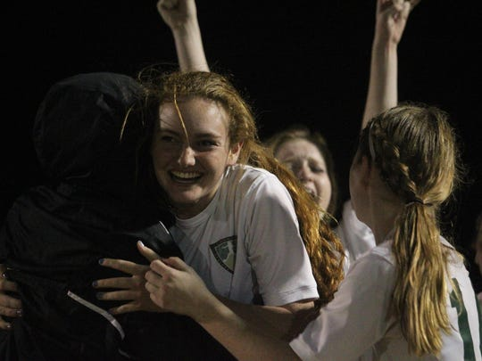 The Lincoln girls soccer team celebrates advancing out of a tough District 2-4A semifinal game Wednesday against Chiles, needing a penalty-kick shootout to do so.