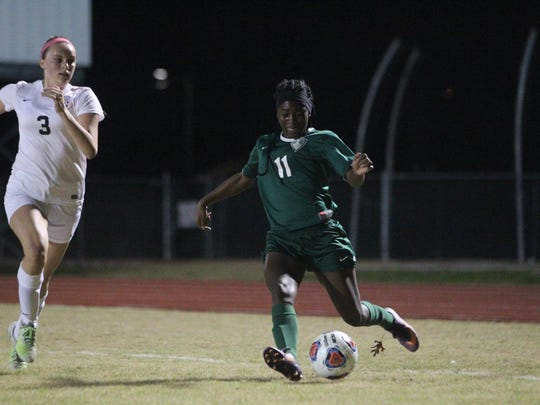 Lincoln's Kiarra Colson rears back for a shot during Thursday's District 2-4A championship against Leon.