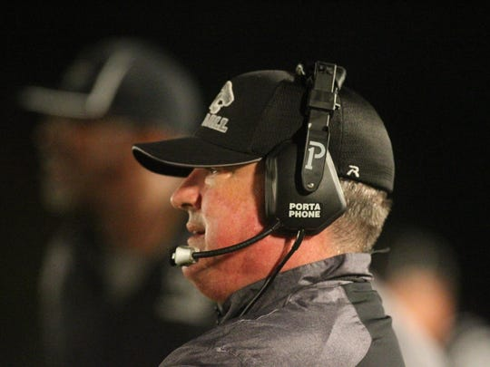 West Gadsden coach Joey Striplin was hired Monday as East Gadsden's head coach with the expectation both West and East will consolidate into one school in the future.