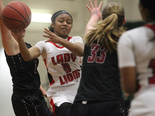 Leon's Amya Bryant drives and passes during Tuesday