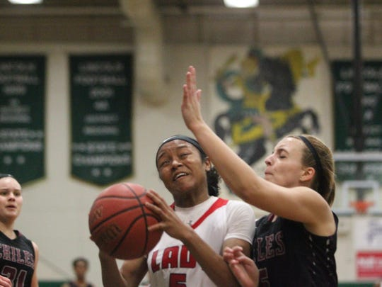 Leon's Amya Bryant takes on contact from Chiles' Kam
