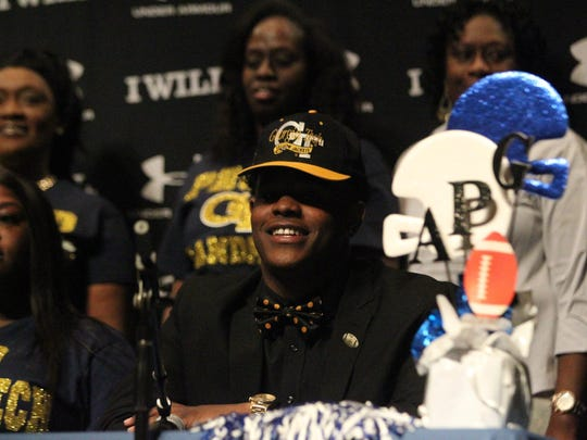 Godby defensive end Antwan Owens was all smiles after signing with Georgia Tech on Wednesday.