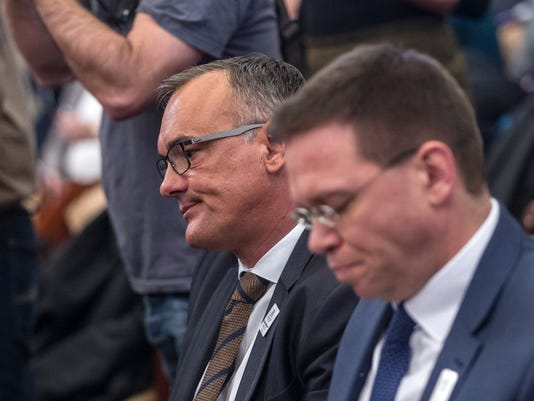 President of the Hungarian Olympic Committee Zsolt Borkai, left, and Head of the bid of Budapest for hosting the 2024 Summer Olympic Games Balazs Furjes attend a session of the General Assembly of the City of Budapest in the town hall in Budapest, Hungary, Wednesday, Feb. 22, 2017.  (Zsolt Szigetvary/MTI via AP)