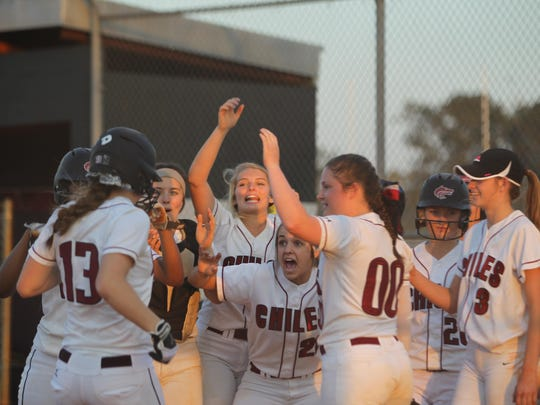 Chiles' Caroline Jacobsen is welcomed home by her teammates after hitting a 3-run home run during Tuesday night's game against Godby.