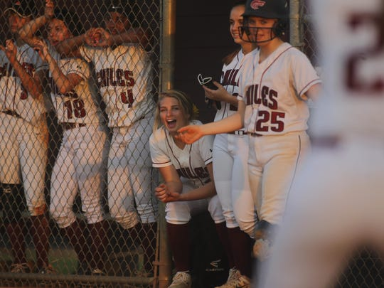 Chiles' Allie Lavoie (seated) cheers on her team as they bat during Tuesday night's game against Godby.