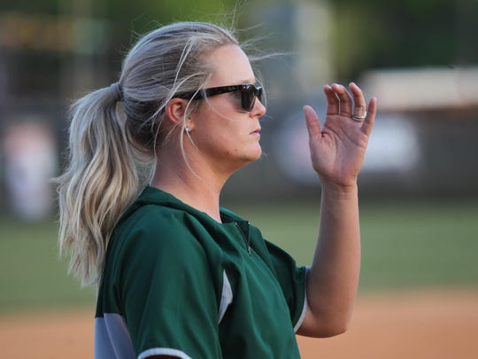 Lincoln coach Terese Waltman -- formerly Terese Gober before getting married since last spring -- coaches at third base during a 22-5 district win at Leon on Tuesday night.