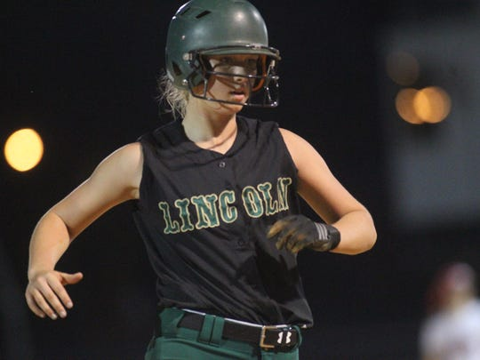 Lincoln's Caston Shields trots into third base after a teammte moves her around during a 22-5 district win at Leon on Tuesday night.