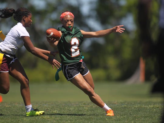 FAMU DRS quarterback Ashanti Lamb gets around the edge for a gain while leading her team on a touchdown drive at the Capital City Classic.