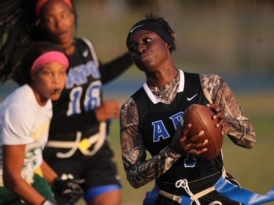 Godby's Mecii Mitchell runs for a gain during a XX-XX win over Lincoln on Monday night in a district semifinal.